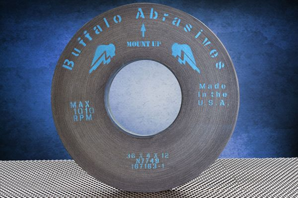 "We manufacture Roll Grinding Wheels,<br>up to 36"" diameter, 600 grit and coarser, Resin, Epoxy, and Shellac bonds<br>for Primary Metals and other Industries"